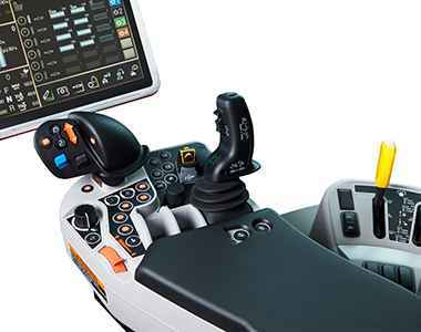 Kubota M7-1 joystick controls from inside the tractor cabin